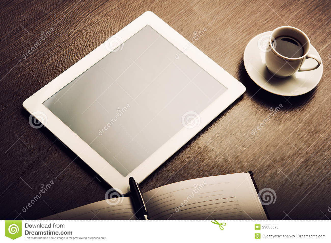 Tablet Pc And A Coffee And Notebook With Pen On The Office ...