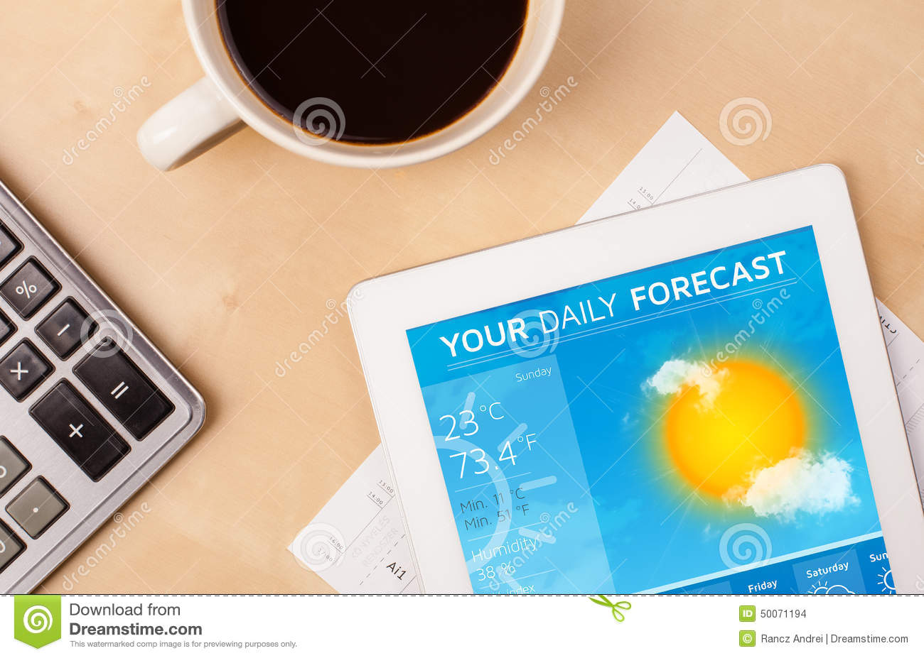Tablet Pc Showing Weather Forecast On Screen With A Cup Of