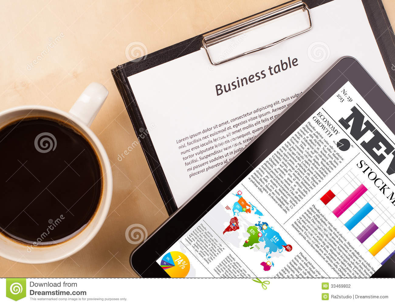 Tablet Pc Shows News On Screen With A Cup Of Coffee On A