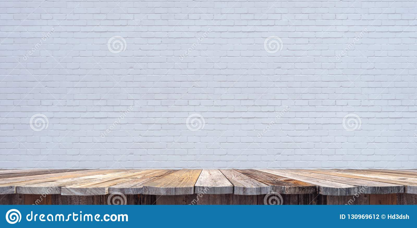 tabletop template with old wooden planks and white brick wall in