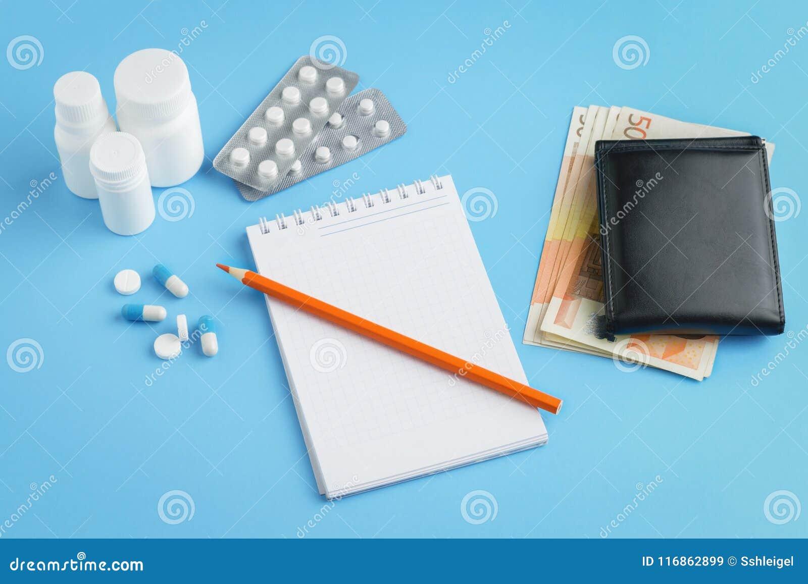 Tabletten, pillen, capsules, pillen met potlood en bankbiljetten van 50 euro
