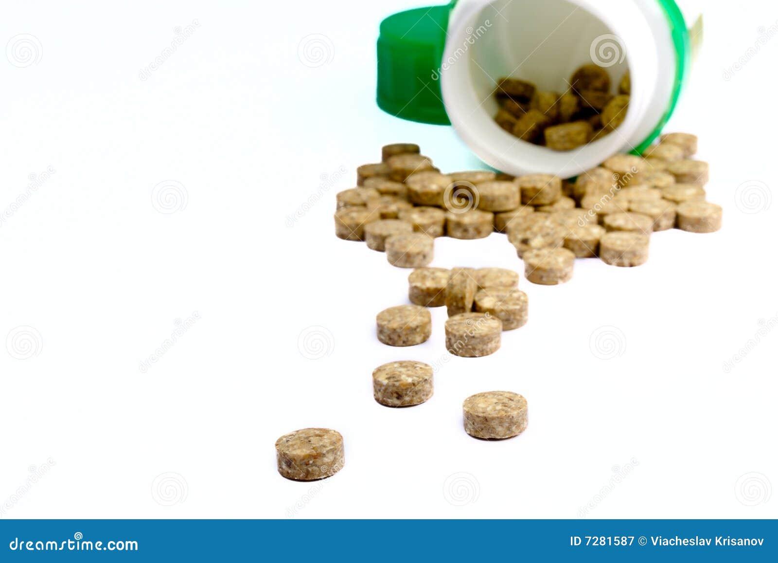 Tablillas herbosas con un tarro