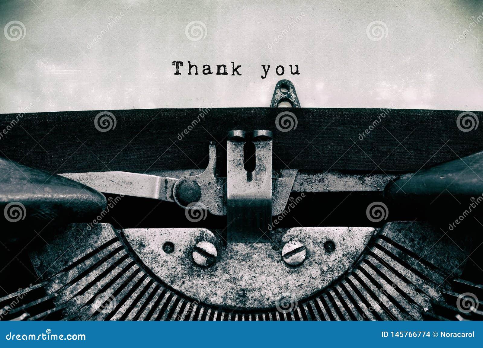Tacka dig ord som skrivas på en tappningskrivmaskin
