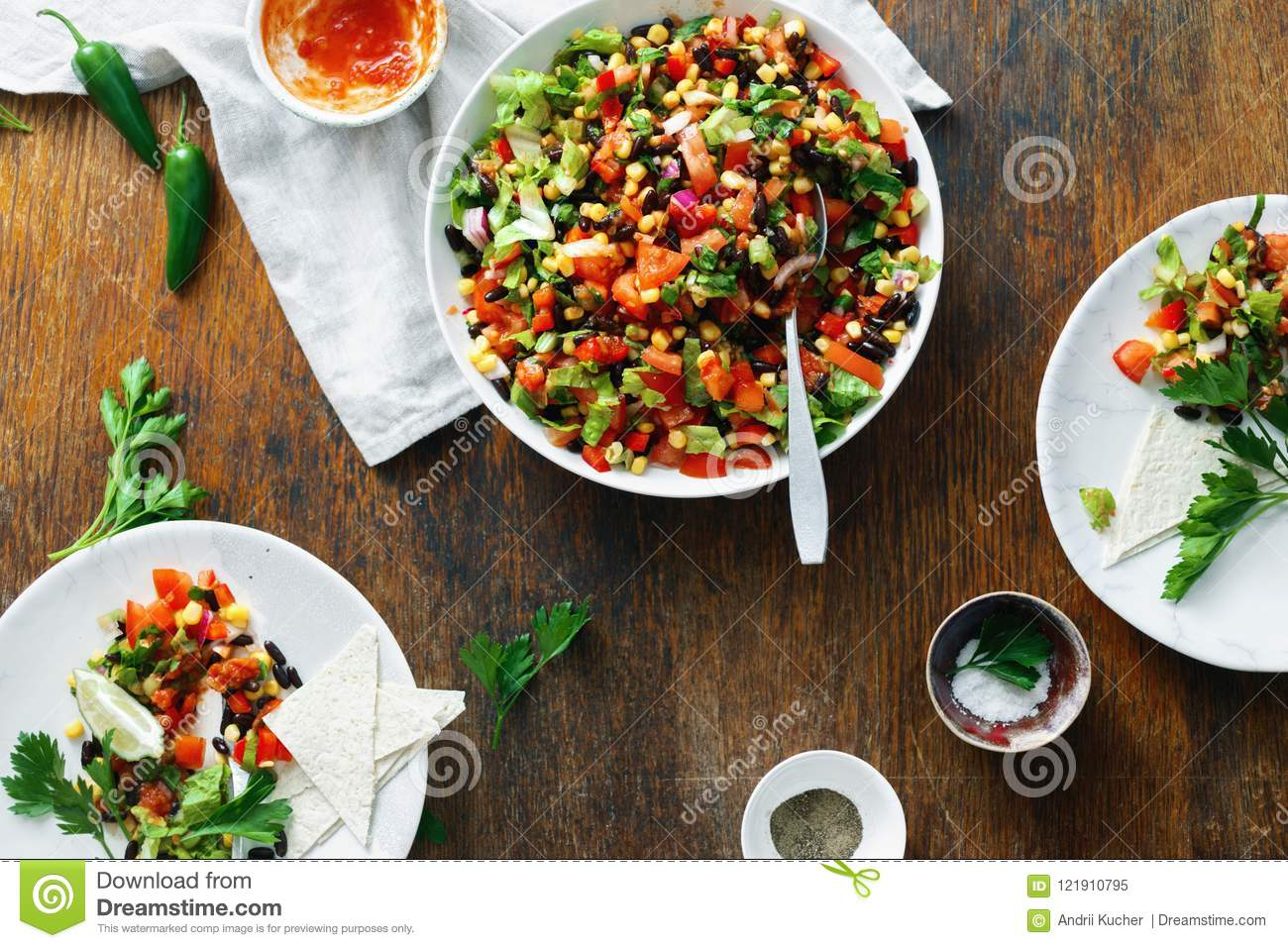 Taco salad on wooden table top view Dinner table
