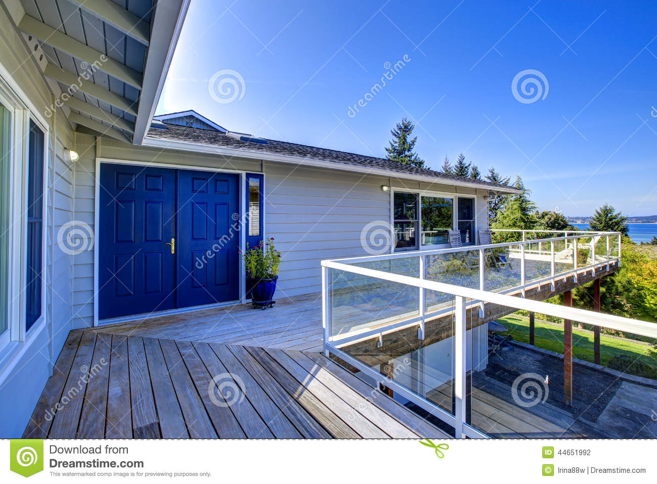 Tacoma real estate house with wrap around walkout deck for Deck around house