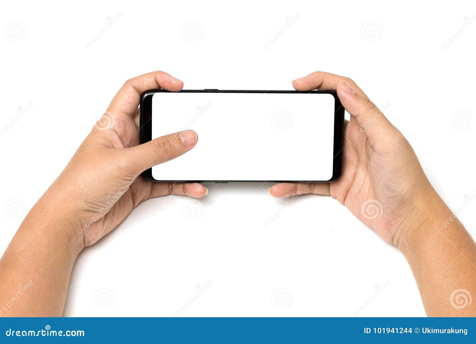 Tacto del teléfono celular y del finger de tenencia de la mano en la pantalla blanca en blanco