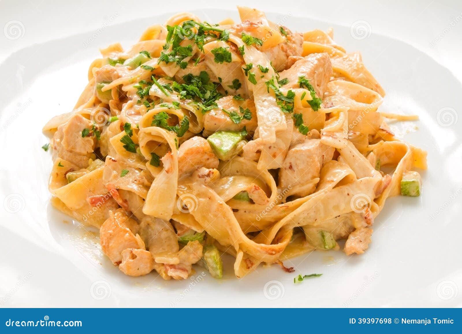Tagliatelle Chicken Pasta creamy cheese sauce and zucchini on white ...