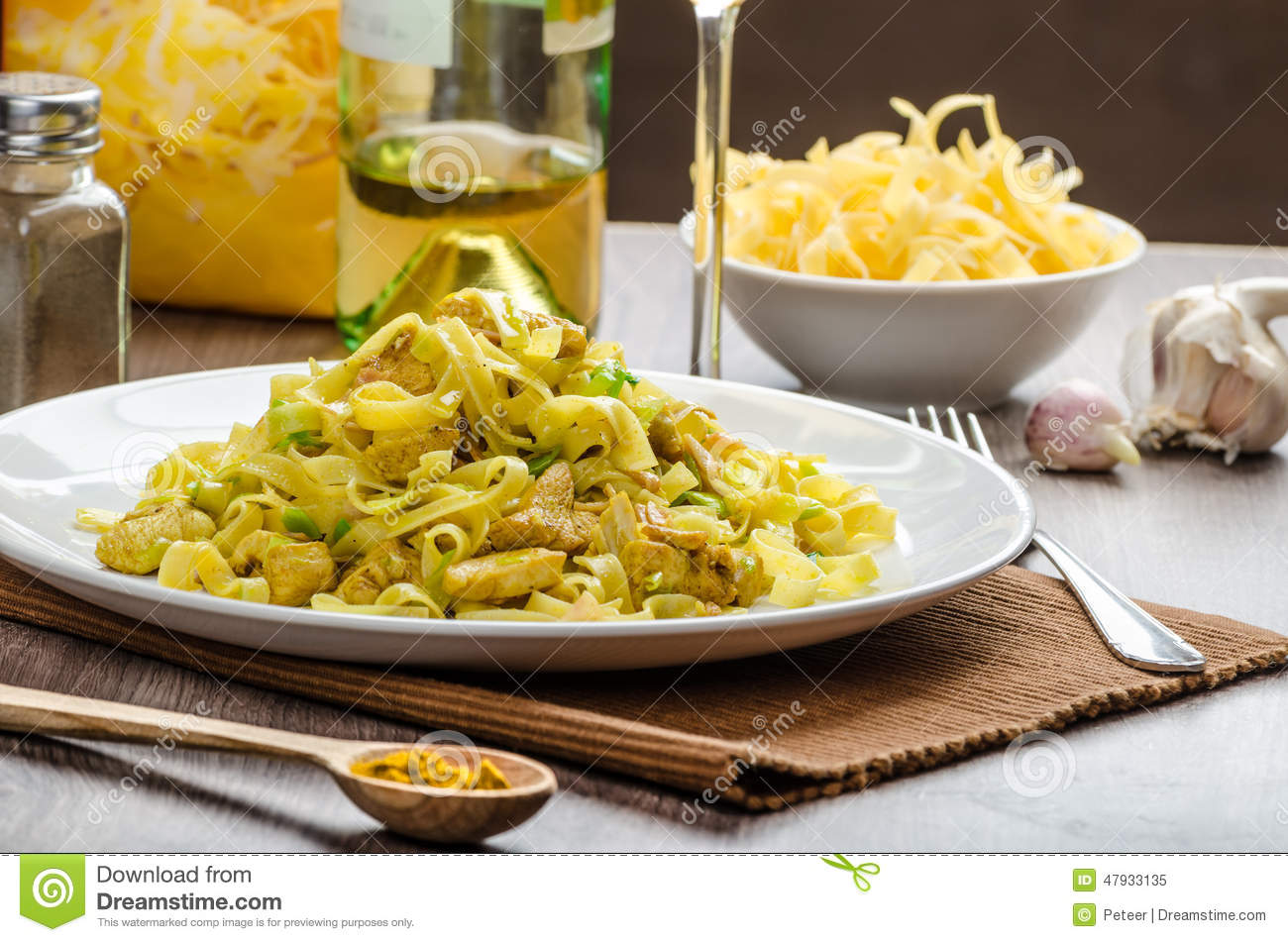 Tagliatelle With Chicken Curry, Leek And Garlic Stock Photo