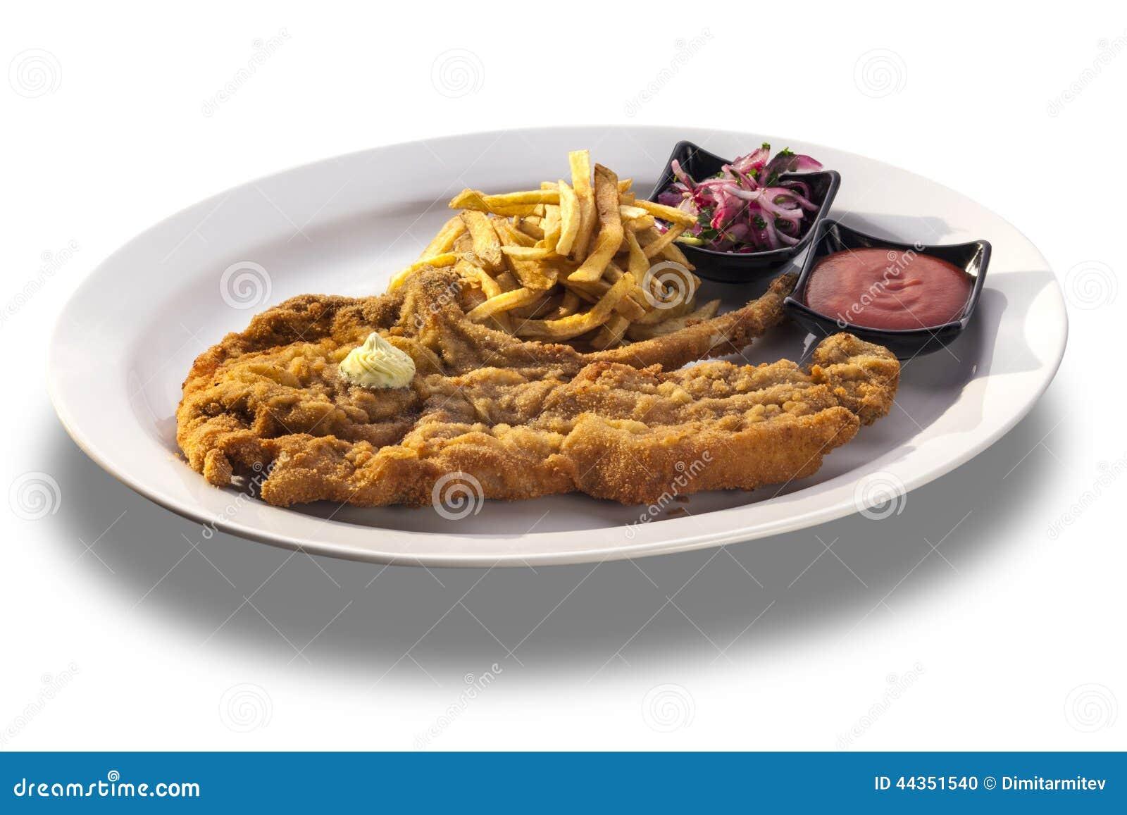 Taglio di agnello delizioso con le patate fritte, la salsa piccante e il oni fresco
