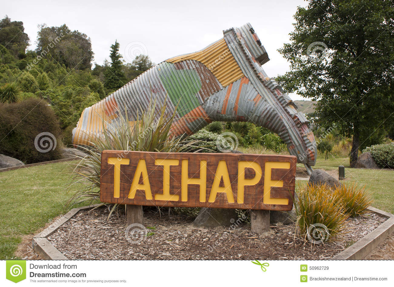 Taihape New Zealand  City pictures : Sign and corrugated iron gumboot in Taihape, New Zealand.