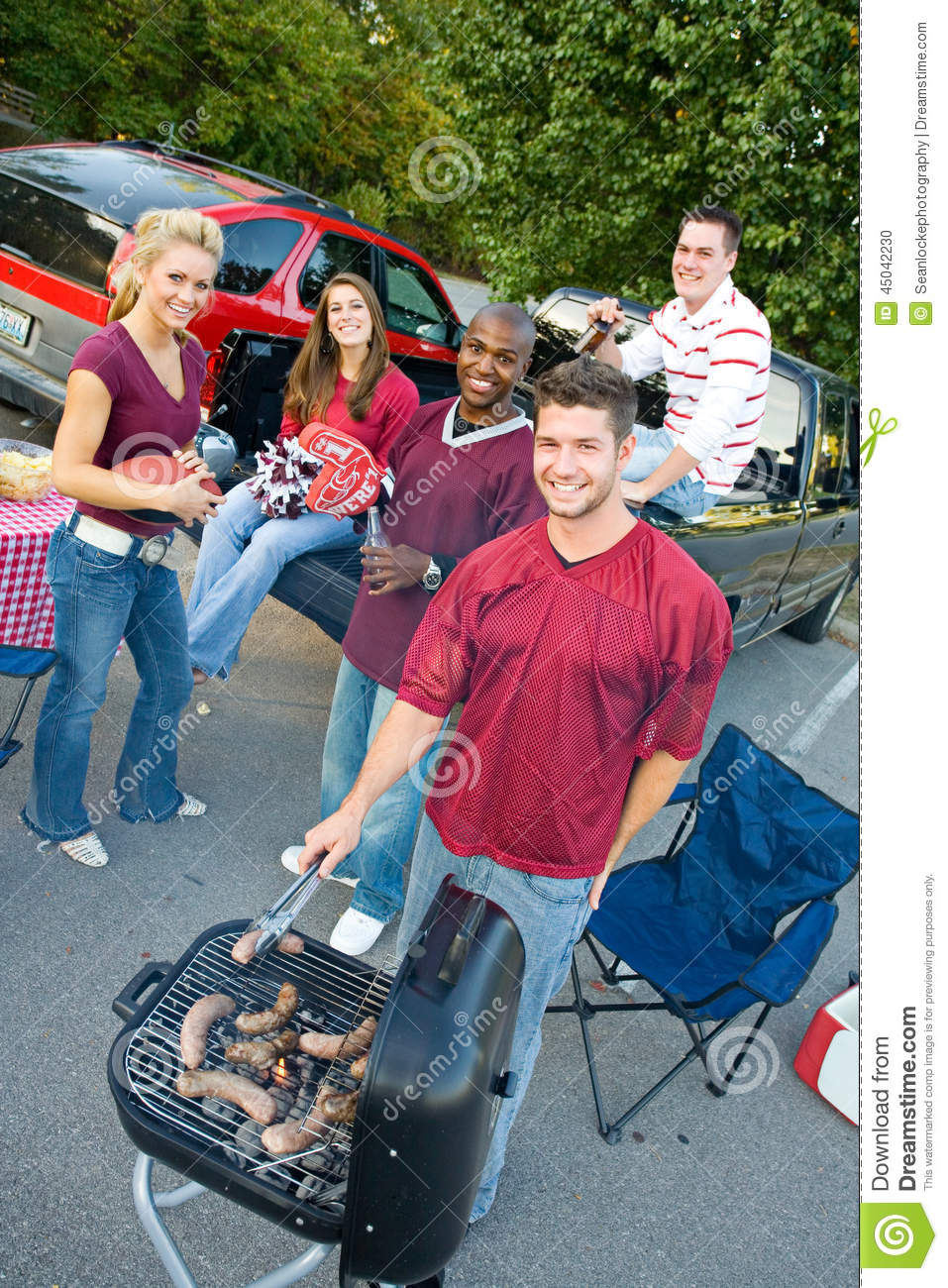Tailgating: Smiling Group Waits For Tailgate Food To Cook