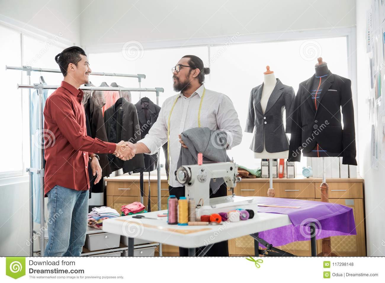 Tailor with his customer talking stock photo image of deal download comp m4hsunfo