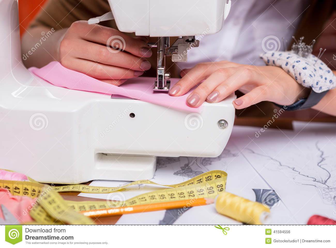 tailor working on sewing machine stock photo image