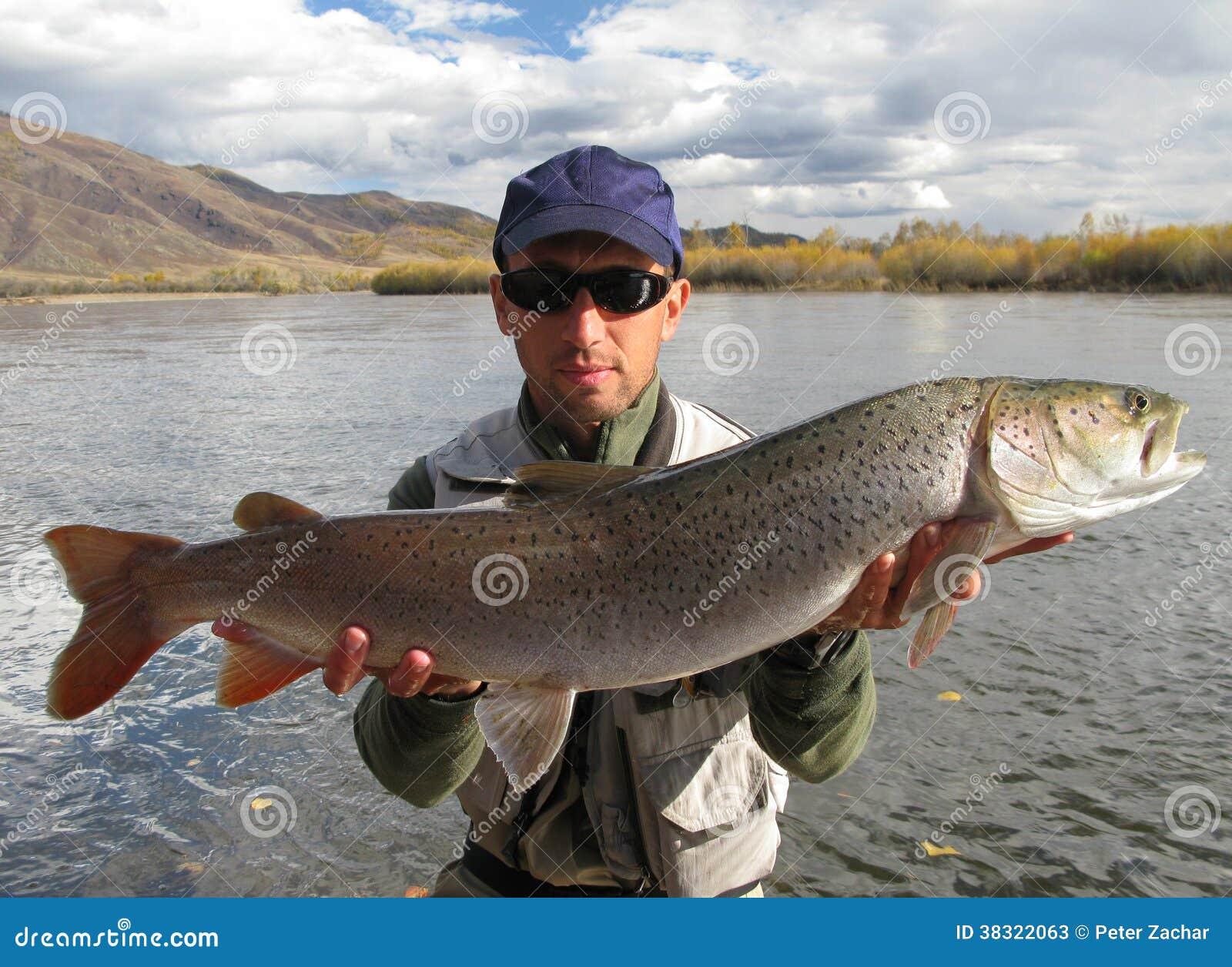 Taimen fishing mongolia stock photos image 38322063 for Taimen fishing mongolia