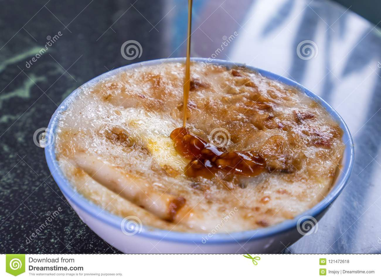 Taiwan`s distinctive famous snacks: Savory rice pudding Wa gui in a white bowl on stone table, Taiwan Delicacies