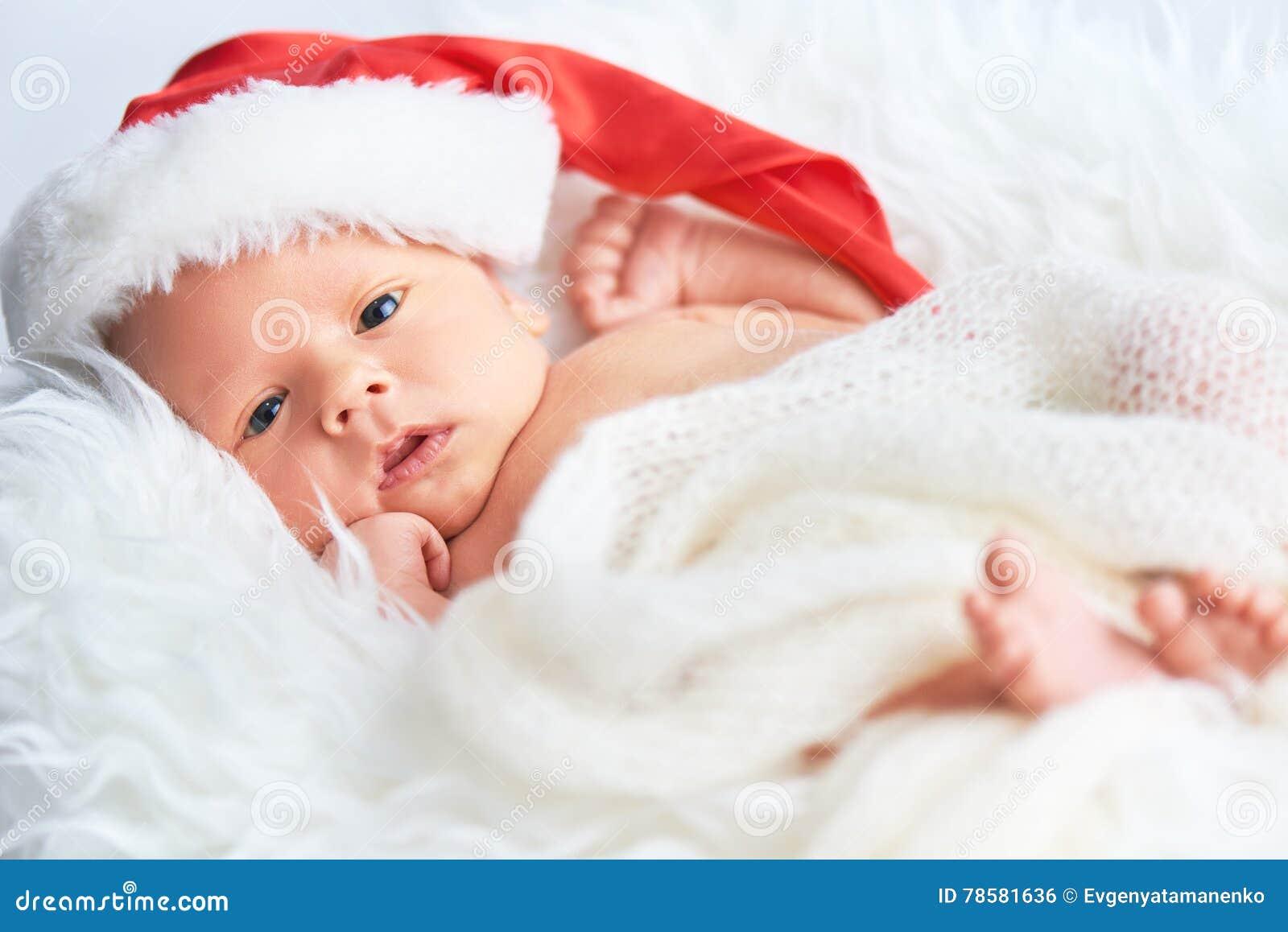 Tajnego agenta nowonarodzony dziecko w Bożenarodzeniowej Santa nakrętce