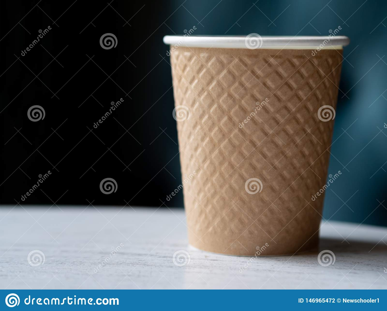 Take away a plastic cup of coffee