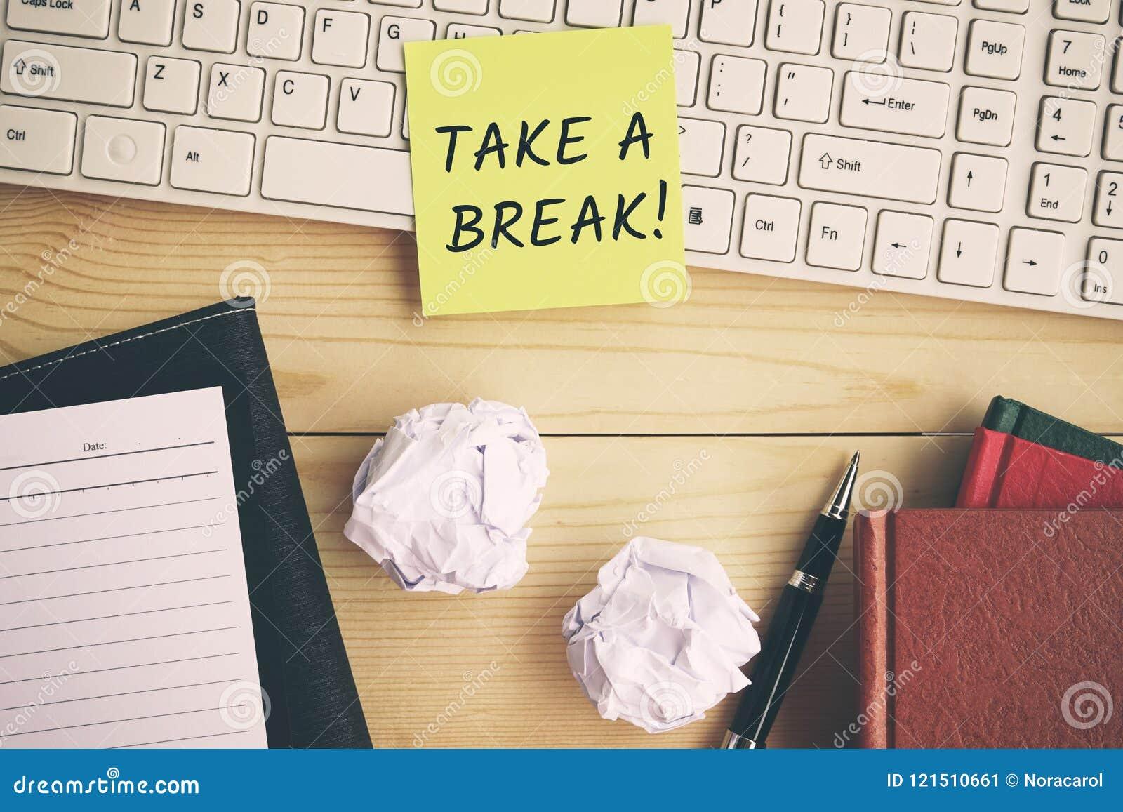 Take a break text on yellow paper