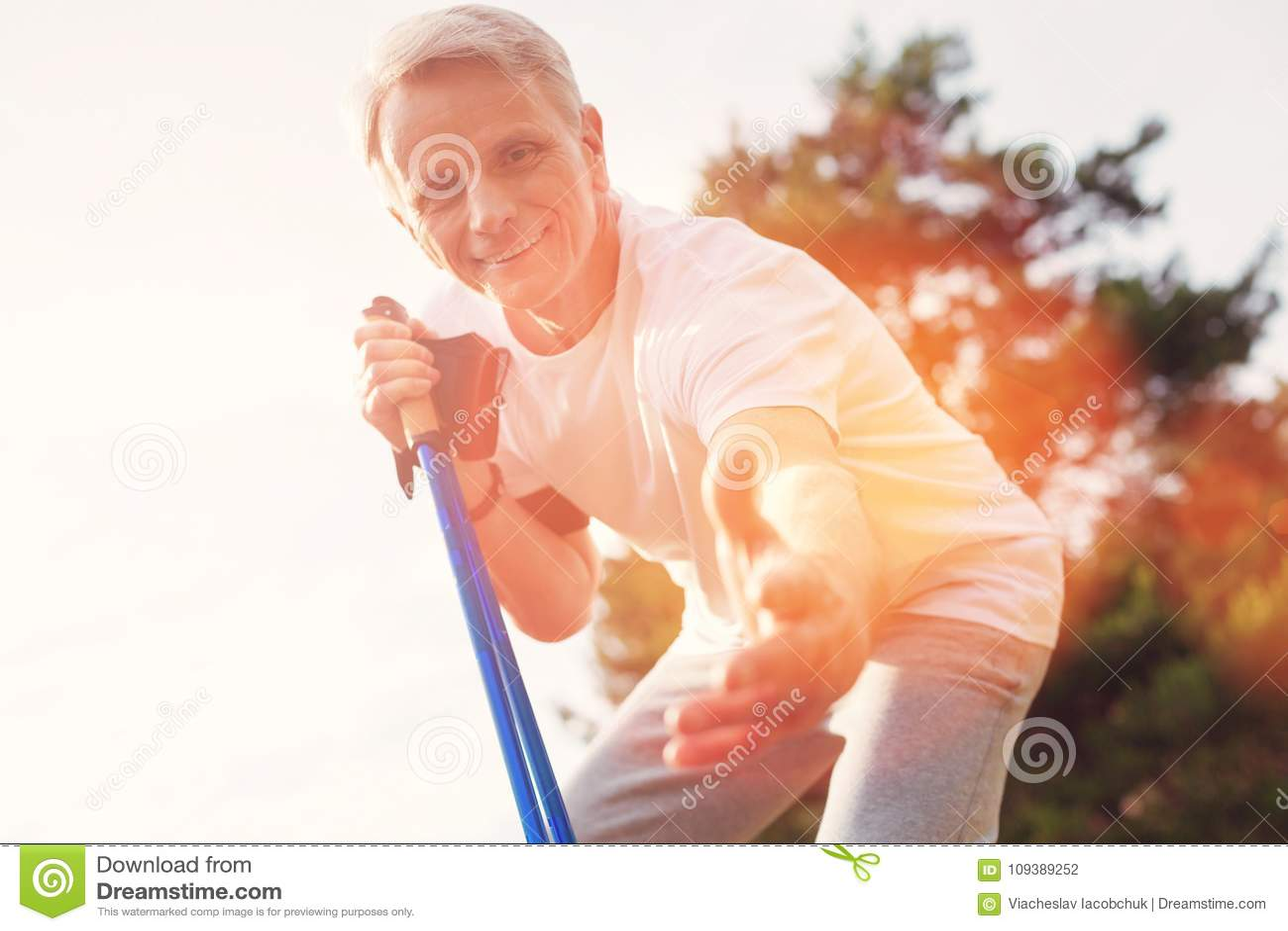 Close up of positive elderly man