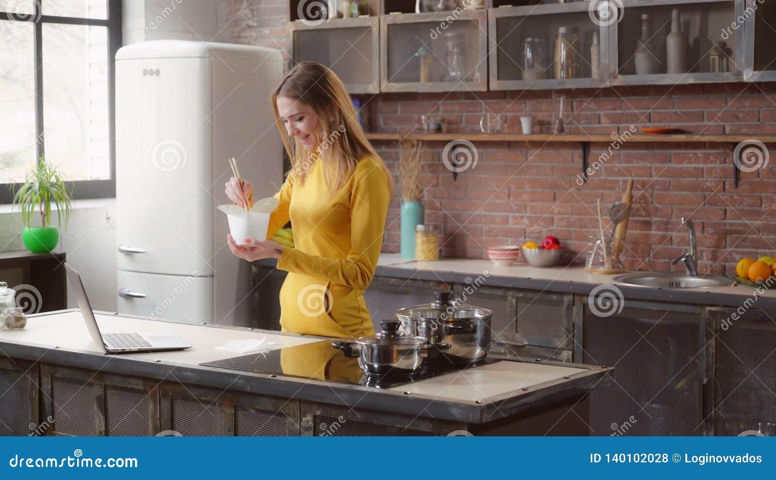 Lady enjoy asian cuisine in flat.