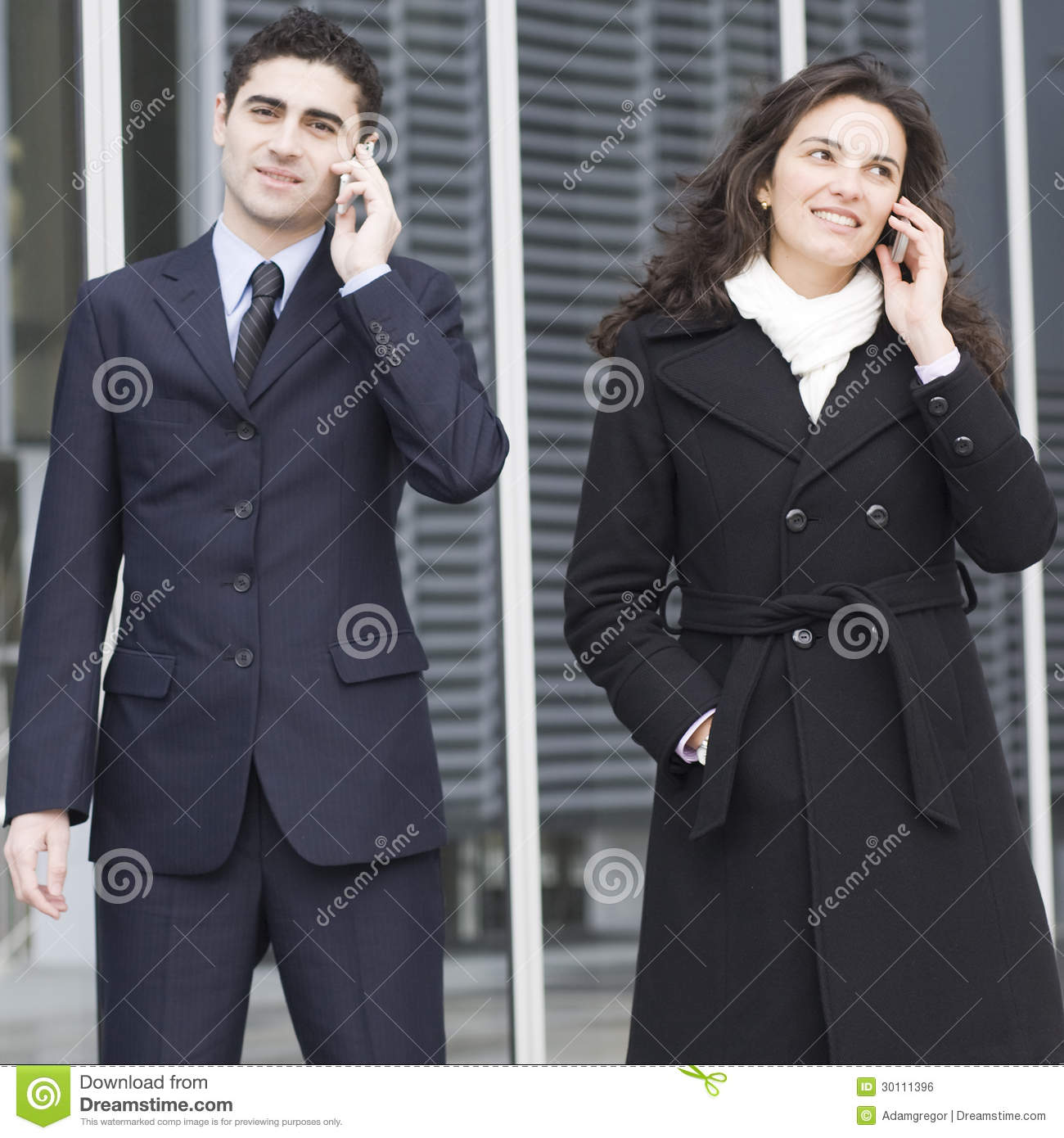 Two businesspeople calling outside