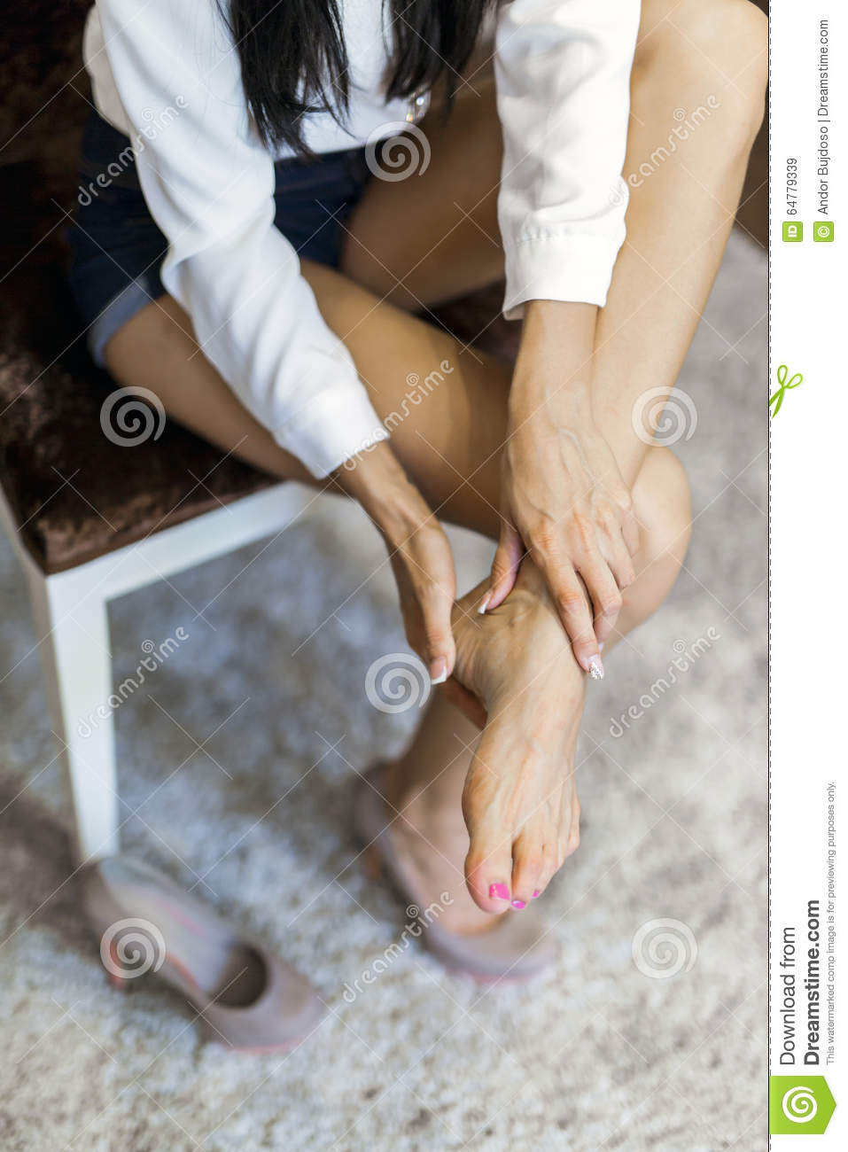 taking off shoes after a long walk can be paniful stock photo