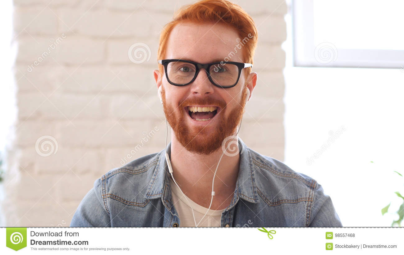 Taking Online, Video Chat, Skype by Man with Beard and Red Hairs