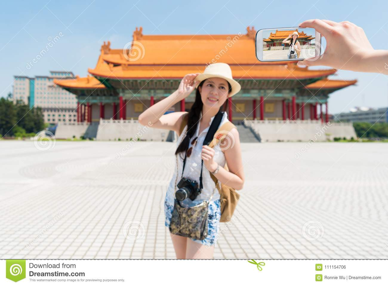 Modern Asian Teem Taking Photos In Front Of Chiang Kai Shek Memorial Hall Joyfully Standing Like A Model Wearing Short Clothes On A Side View