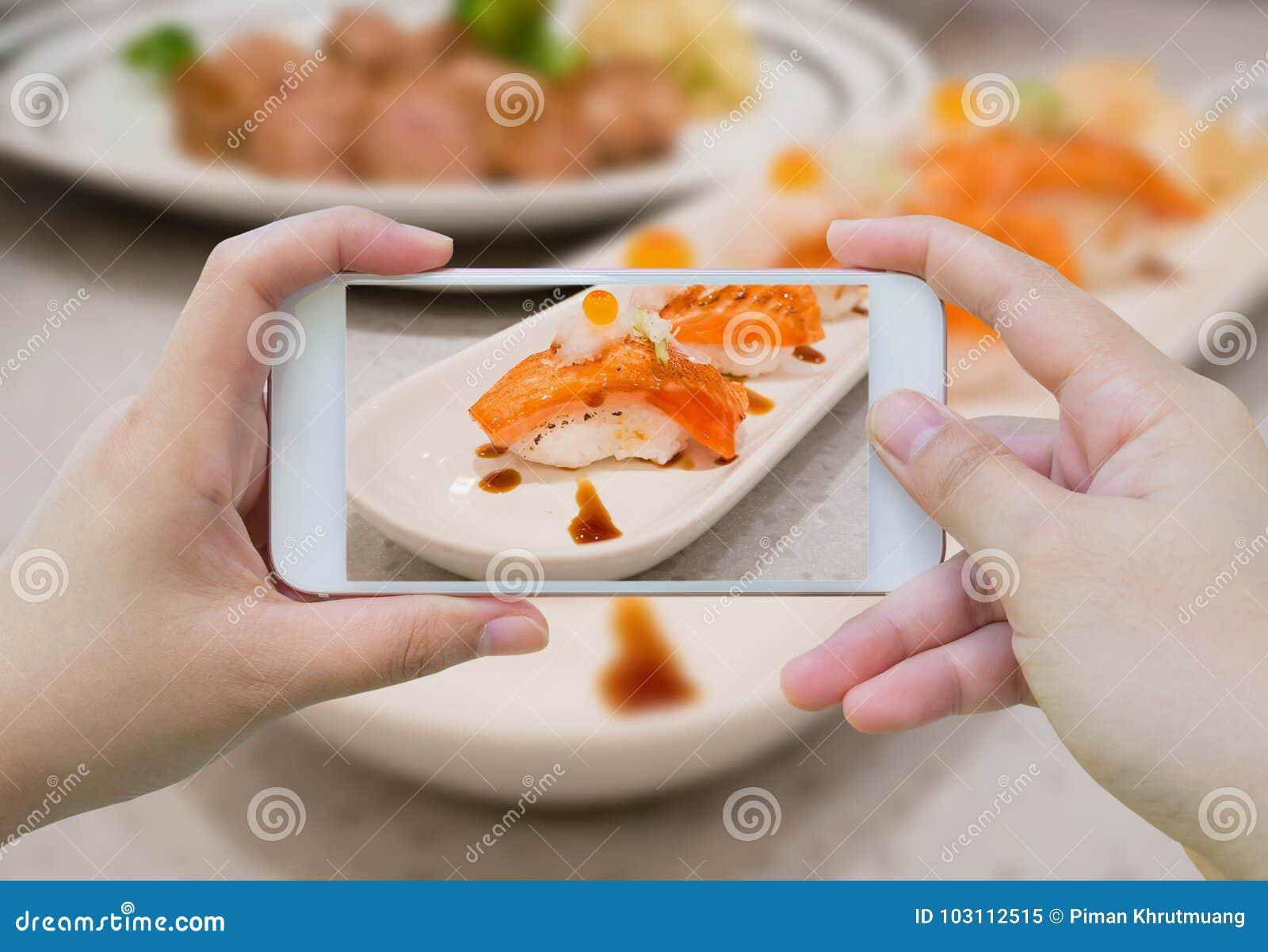 Taking photo of Grilled salmon sushi