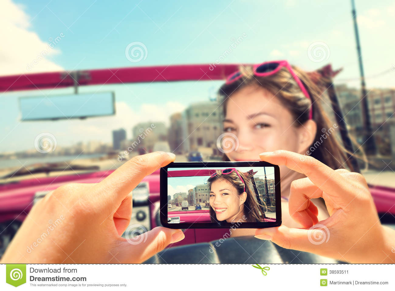 Taking pictures with smart phone of woman in car