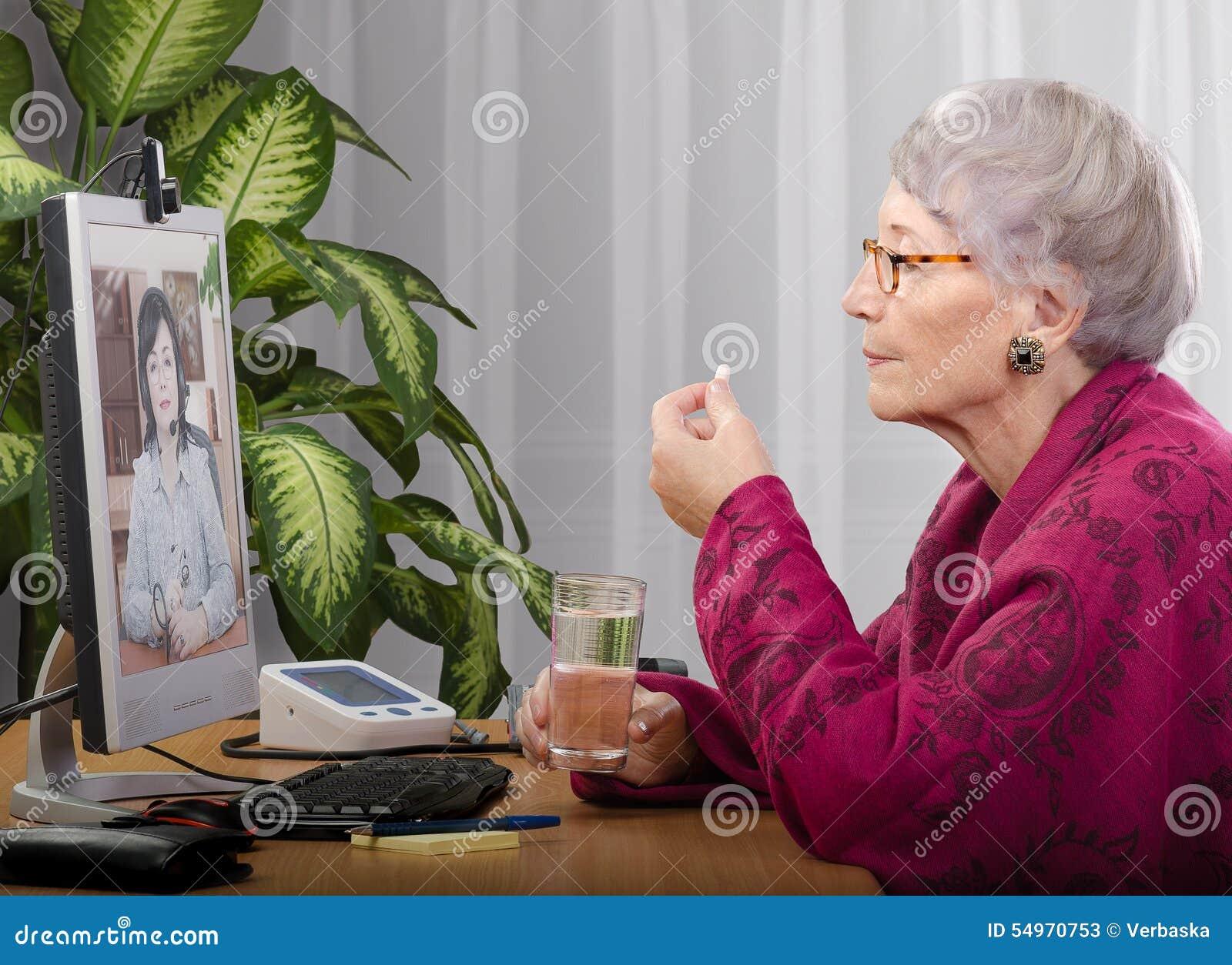 taking tablet during virtual doctor visit stock photo image 54970753. Black Bedroom Furniture Sets. Home Design Ideas