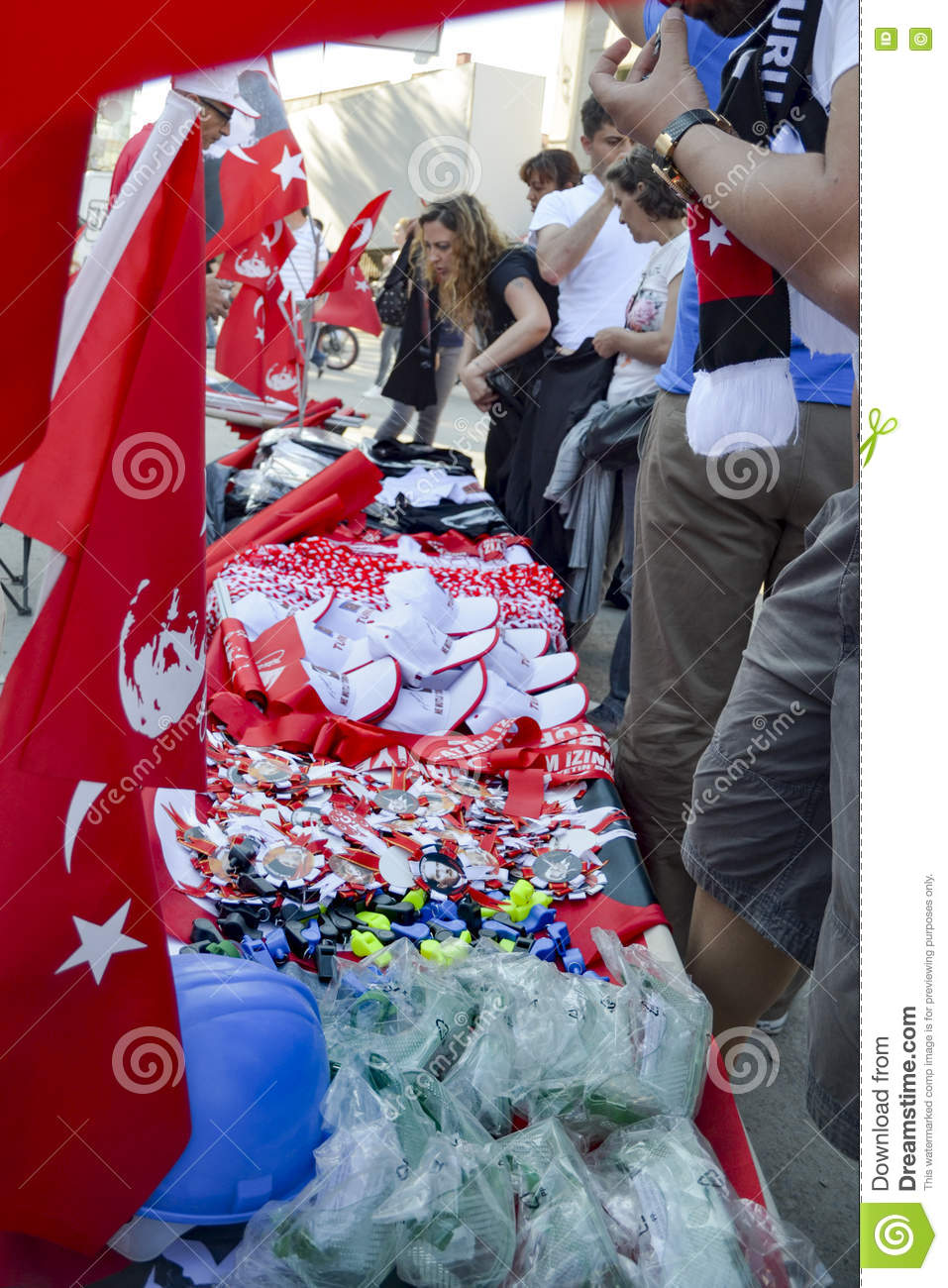 Taksim Gezi Park protests and Events.Products sold in the protest area, Helmet, Whistle, badges, flags, hats, gas masks.