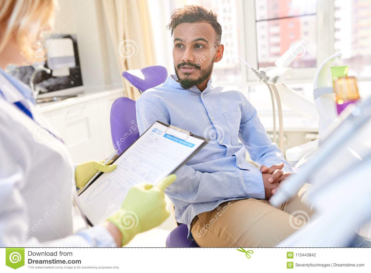 Talented Odontologist Having Appointment