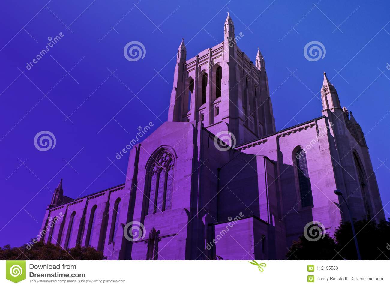 Tall downtown Los Angeles Catholic Church in twilight purple haze.