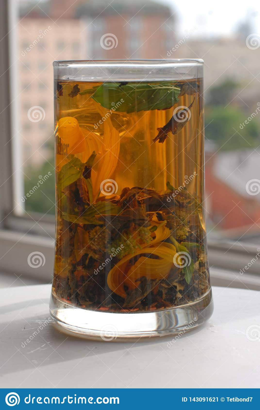 Tall glass cup with aroma herbal tea