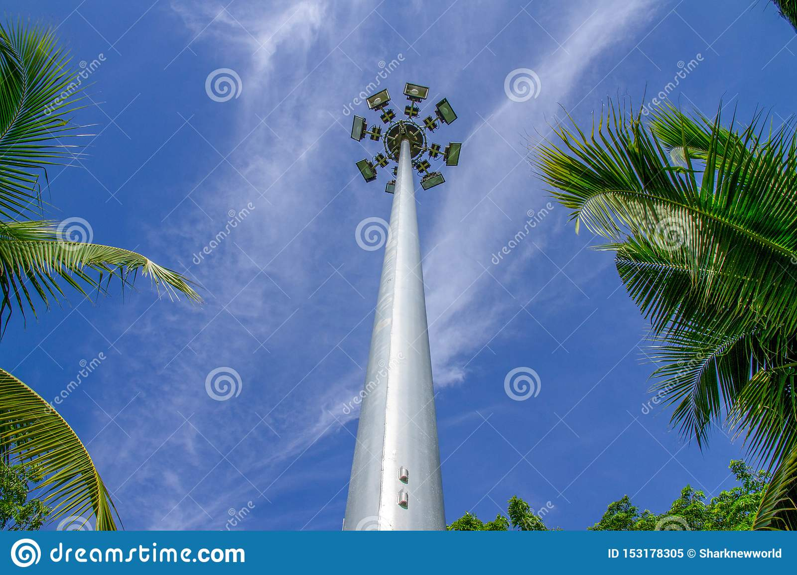 Tall lamp post intersect with blue sky.