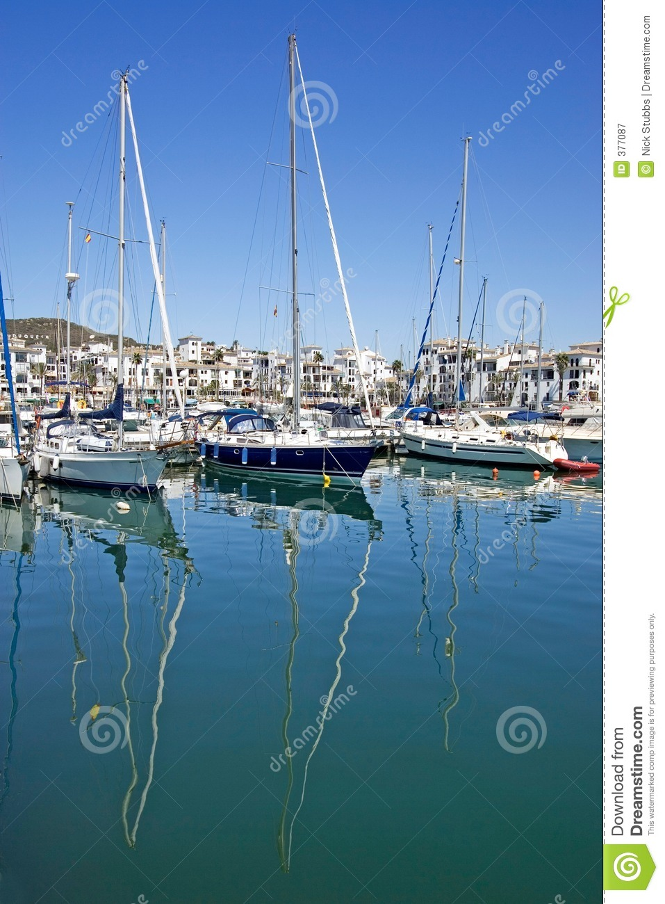 Tall luxury boats and yachts moored in Duquesa port in Spain on