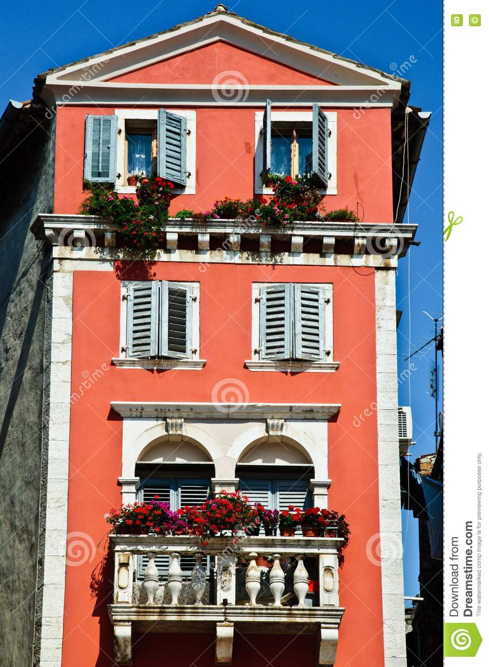 Tall Old European House With Red Walls Stock Photo