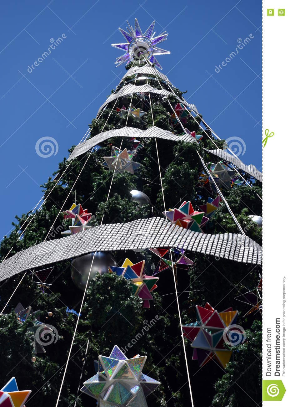 How to decorate tall outdoor christmas tree - Tall Outdoor Christmas Tree With Decoration Stock Photo