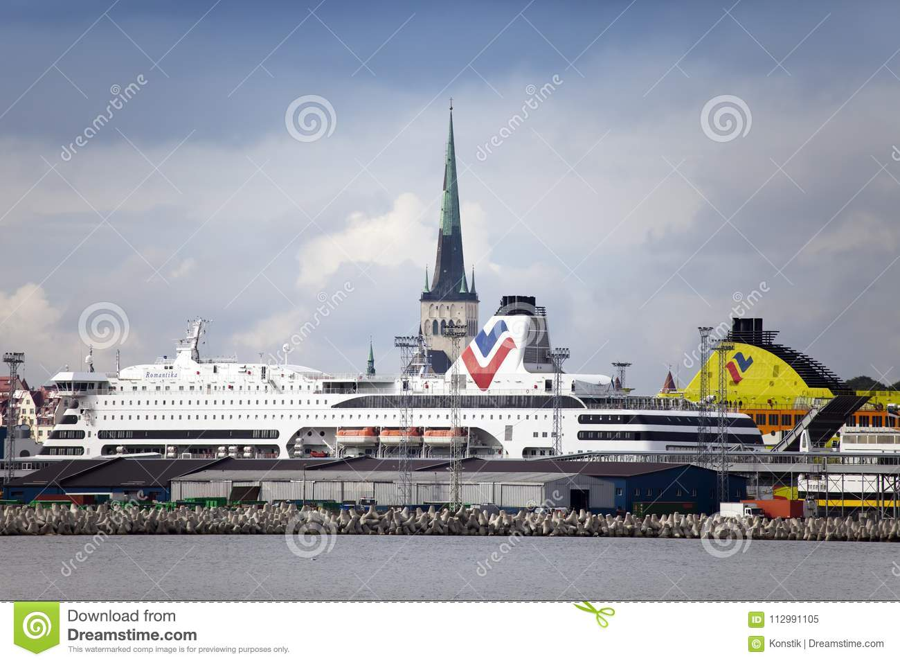 TALLINN, ESTONIA- SEPTEMBER 7, 2015: The big cruise ship in port and a spike of ancient church