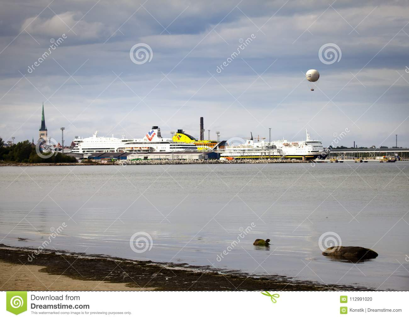 TALLINN, ESTONIA- SEPTEMBER 7, 2015: Cruise ship in port with old town and balloon in background
