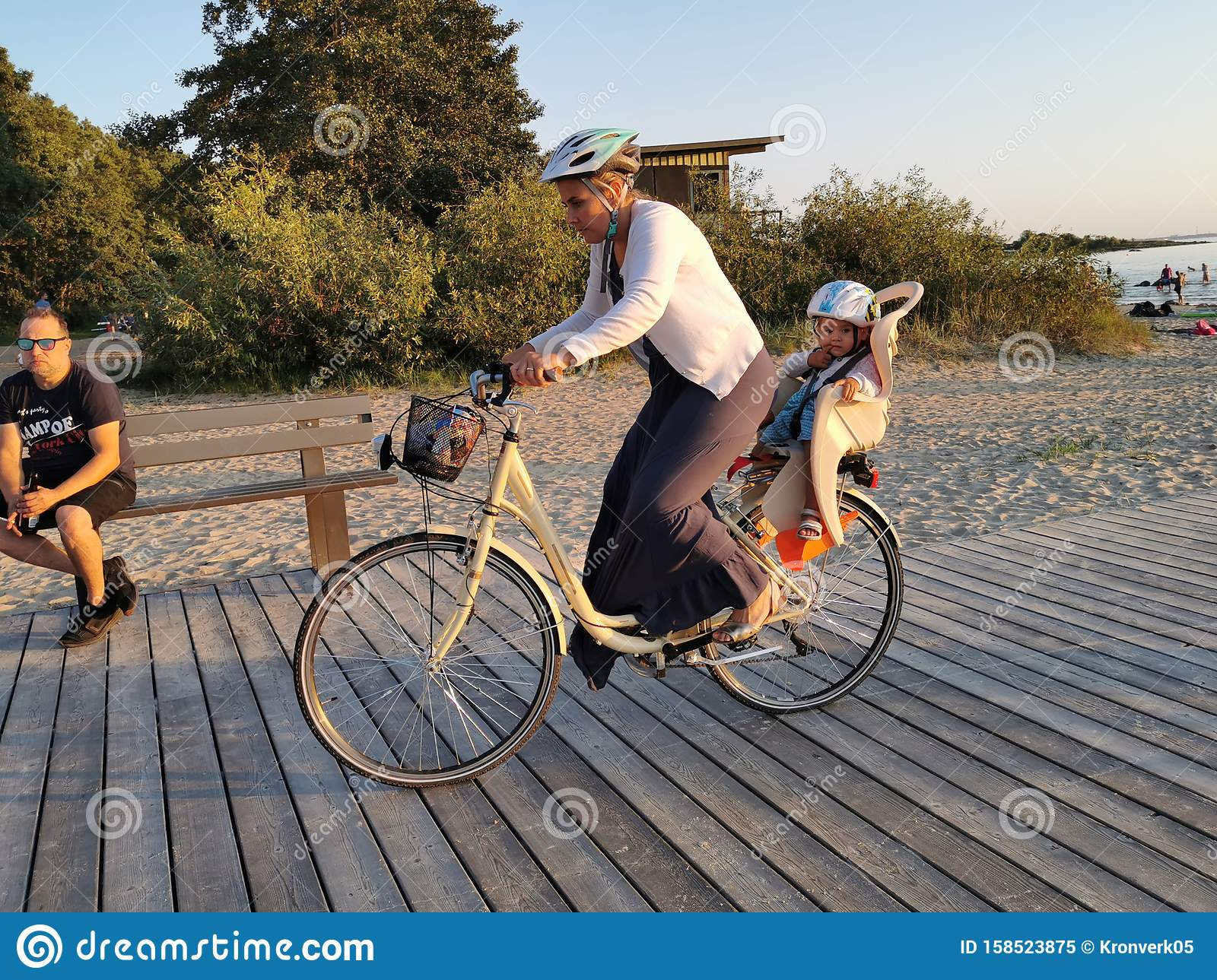 Tallinn, Estonia - 09.2019. silhouettes of a Bicycle against the sunset on the sea. Adults and children Cycling