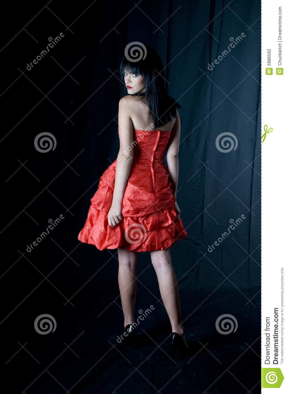 Talya red dress looking back