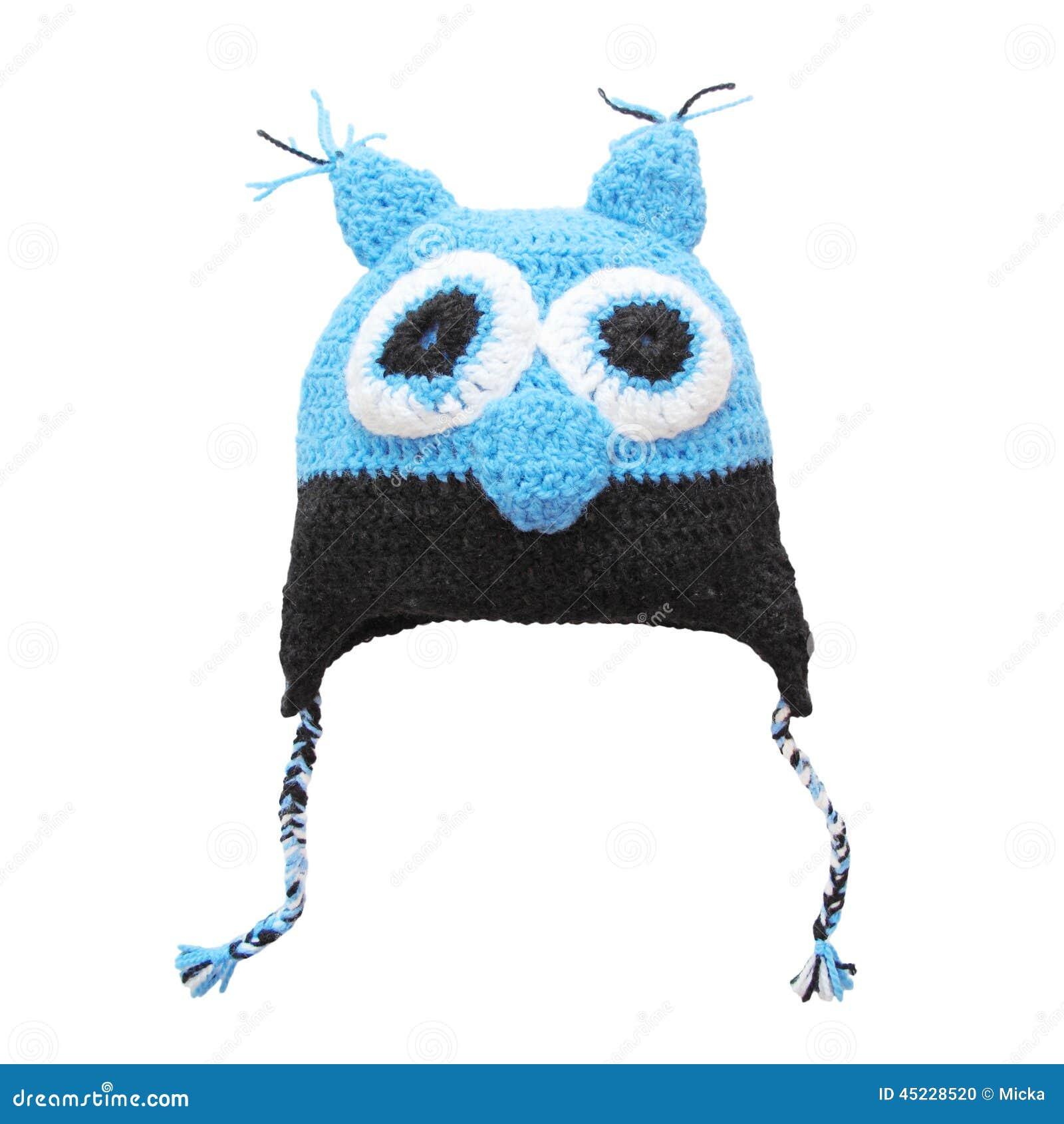 70170bc7b2 Tampão de lã da coruja para a criança isolada no branco Fazer crochê o  chapéu bonito feito a mão