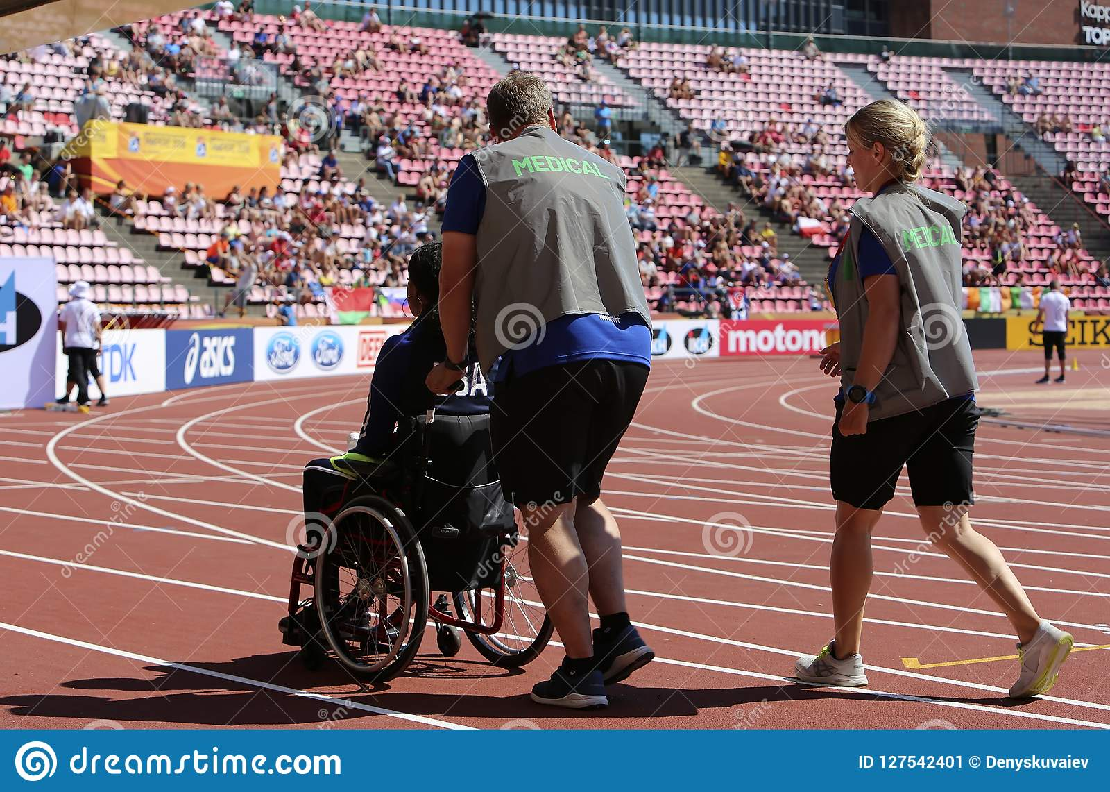 TAMPERE, FINLAND, July 10: Medical assistants helping injured athlete in the IAAF World U20 Championship in Tampere, Finland
