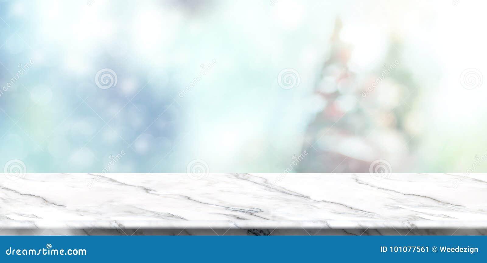 Tampo da mesa de mármore branco vazio com Natal silenciado abstrato do borrão
