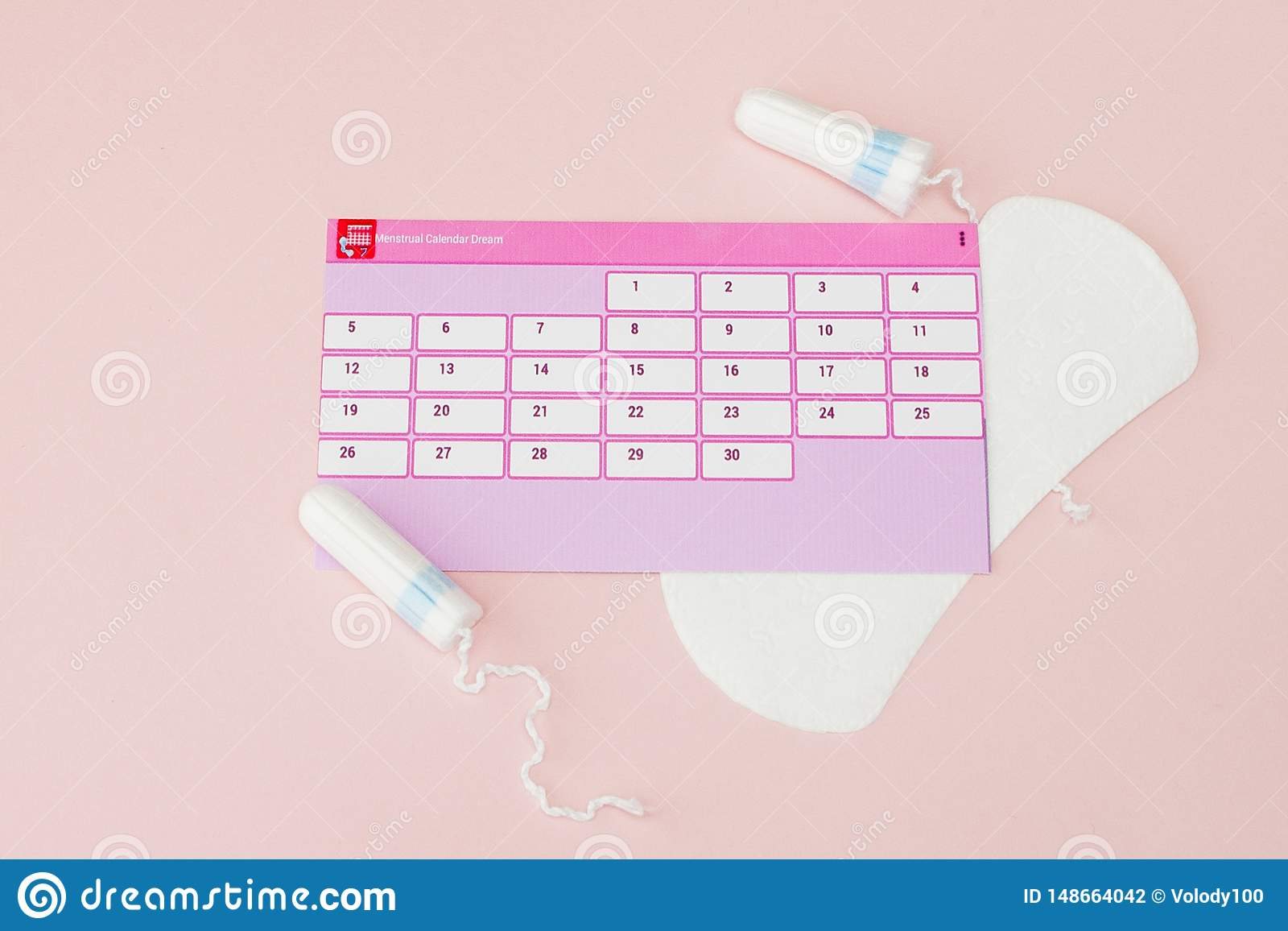 Tampon, feminine, sanitary pads for critical days, feminine calendar, pain pills during menstruation on a pink background.