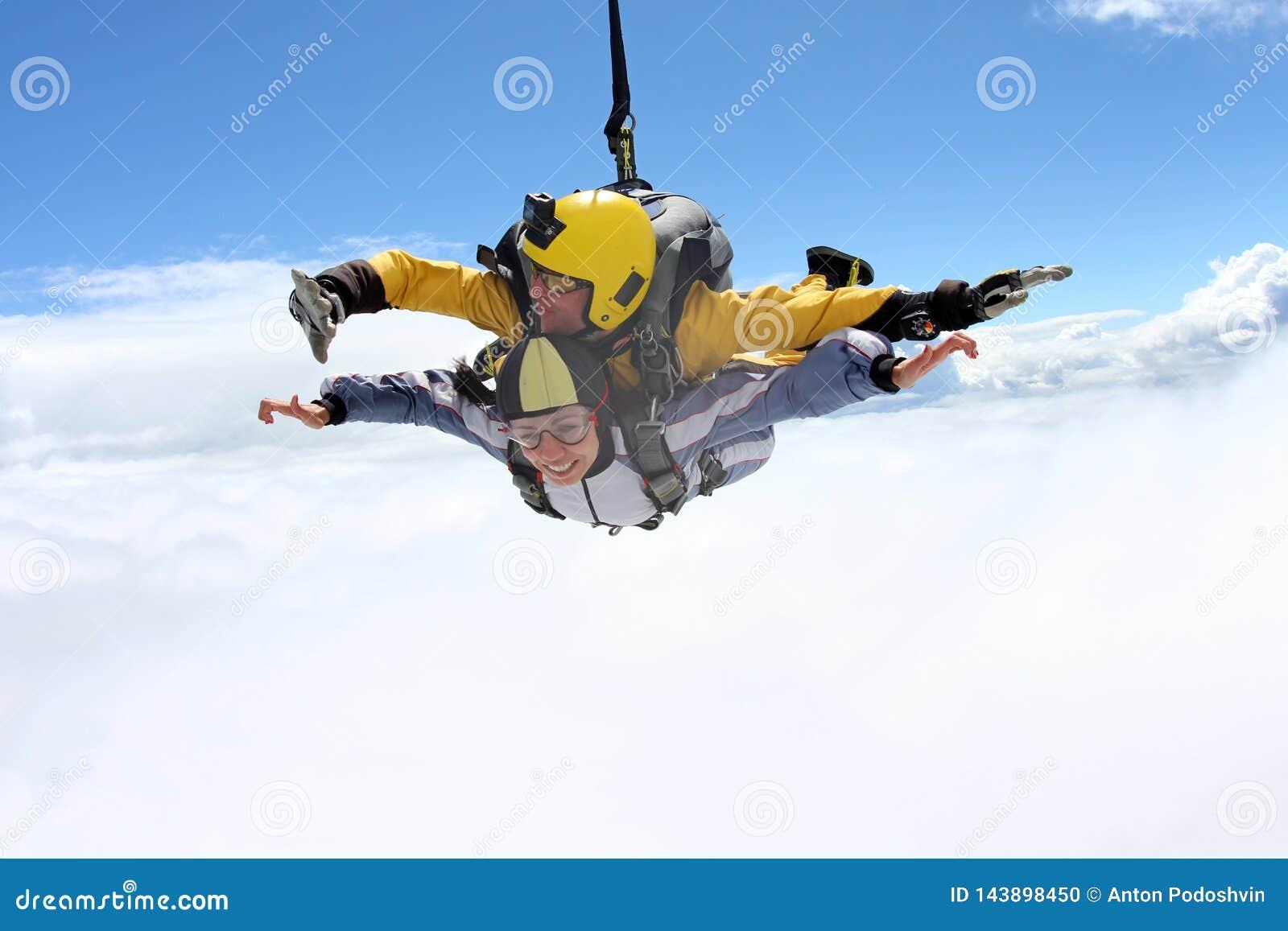 Tandem jump. Skydiving in the blue sky.