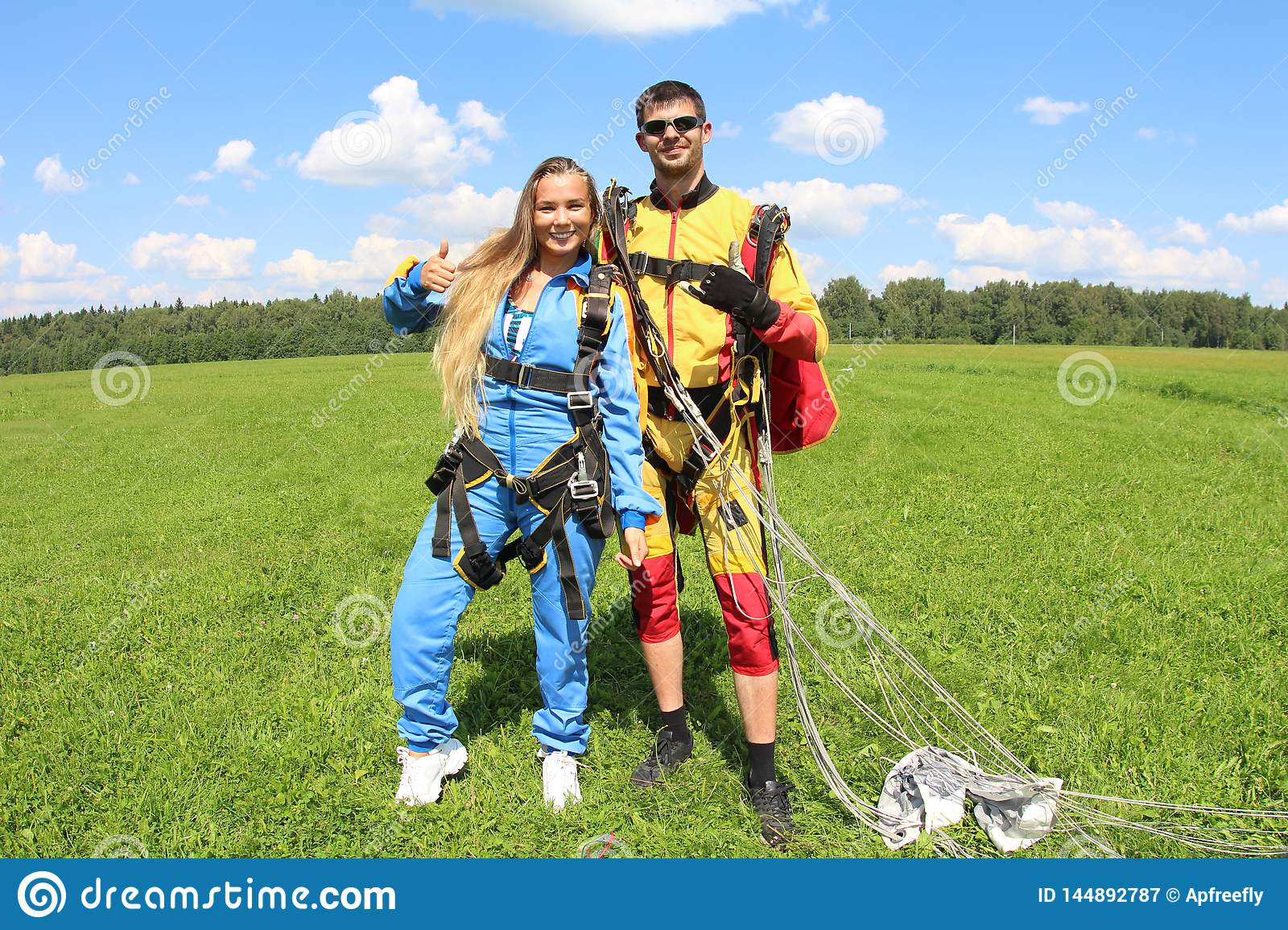 Tandem Skydiving  Instructor With Girl  Stock Image - Image