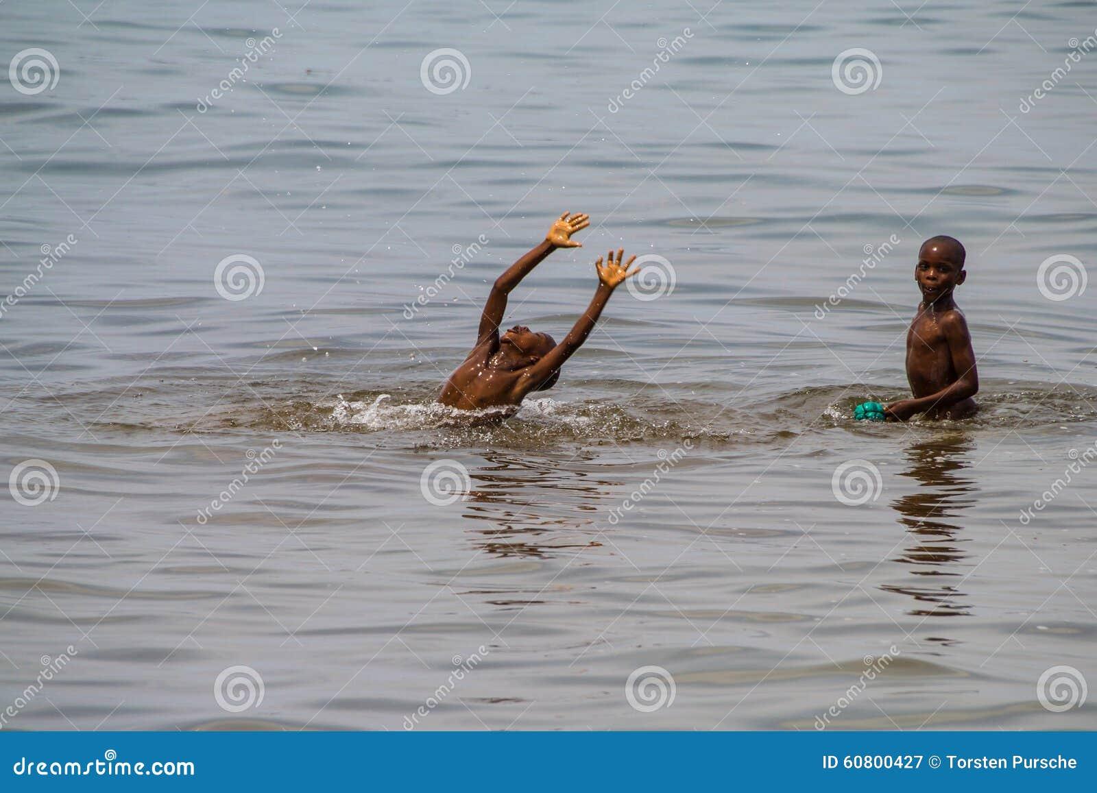 Kids Swimming In A Lake tanganyika kids swimming in the lake editorial photography - image